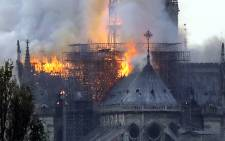 Flames rise during a fire at the landmark Notre-Dame Cathedral in central Paris on 15 April 2019 afternoon, potentially involving renovation works being carried out at the site, the fire service said. Picture: AFP