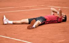 Serbia's Novak Djokovic celebrates after winning the men's final match against Britain's Andy Murray at the Roland Garros 2016 French Tennis Open in Paris on 5 June 2016. Picture: Philippe Lopez / AFP.