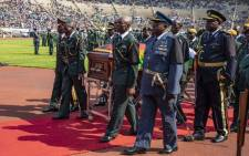 Military officials accompany late former President Robert Mugabe's body into the National Sports Stadium in Harare on 14 September 2019. Picture: Thomas Holder/EWN