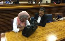 Sindisiwe Manqele, who's accused of killing her rapper boyfriend Nkululeko 'Flabba' Habedi, sits in court ahead of her sentencing on 9 December 2015. Picture: Christa Eybers/EWN.