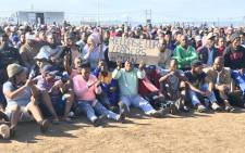 Zwelihle residents wait to meet Police Minister Bheki Cele in Hermanus on 24 July 2018. Picture: Monique Mortlock/EWN