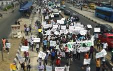 Protesters hold placards and banners during an anti-government demonstration in Lagos, on 6 February, 2017. Picture: AFP.