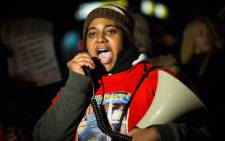 Erica Garner, daughter of Eric Garner, leads a march of people protesting the Staten Island, New York grand jury's decision not to indict a police officer involved in the chokehold death of Eric Garner in July, on 11 December 2014 in the Staten Island neighborhood of New York City. Picture: AFP.