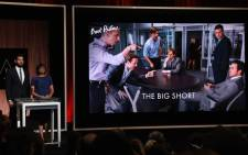 A screen showing the film 'The Big Short' which is an Oscar nominee for Best Picture, is announced by actor John Krasinski and Academy President Cheryl Boone Isaacs during the Academy Awards Nominations Announcement at the Samuel Goldwyn Theater in Beverly Hills, California on January 14, 2016. The 88th Oscars will be held on February 28 at the Dolby Theatre in downtown Hollywood. Picture: AFP.