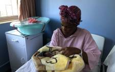 A new mother has a look at her baby at the Tambo Memorial Hospital in Boksburg. Picture: EWN
