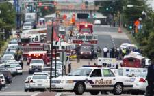 Police and firefighters respond to the report of a shooting at the Navy Yard in Washington, DC on 16 September 2013 where 12 people were shot dead. Picture: Saul Loeb/AFP