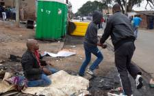 "FILE: ""Four men have been arrested after the fatal stabbing of a Mozambican national Emmanuel Sithole, in Alexandra at the weekend. Picture: James Oatway/Sunday Times"