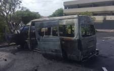 Portesting students at CPUT Cape Town campus have set alight a minibus belonging to a private security company. Picture: Xolani Koyana/EWN.
