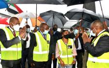 Health Minister Zweli Mkhize, Deputy President David Mabuza, acting Minister in the Presidency Khumbudzo Ntshavheni, and President Cyril Ramaphosa celebrate the arrival of the first million doses of the AstraZeneca COVID-19 vaccine at OR Tambo International Airport on 1 February 2021. Picture: GCIS.
