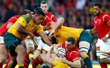 FILE: George North of Wales is tackled to the ground by Australia's David Pocock. Picture: rugbyworldcup.com