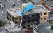 This aerial view shows the rescue and recovery scene after a fire at an animation company building killed some two dozen people in Kyoto on 18 July 2019. Picture: AFP