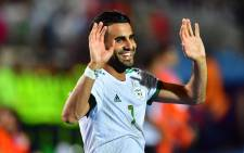 Algeria's Riyad Mahrez celebrates after winning the 2019 Africa Cup of Nations (CAN) Final football match between Senegal and Algeria at the Cairo International Stadium on Friday.  Credit: AFP