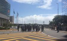 FILE: Cape Town police monitor the situation as asylum seekers protest outside Home Affairs building on 27 November 2014. Picture: Anja Knoblauch @Anja_Knoblauch