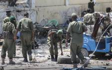 FILE: Somali security forces gather in front of a government builidng that was attacked by militants from Islamist group al-Shabab in Mogadishu, Somalia. Picture: EPA.