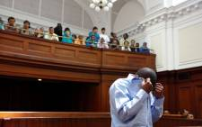 FILE: Zola Tongo (C) covers his face as he attends a session at the Cape Town High Court  on 7 December 2010. Picture: EPA/NIC BOTHMA.