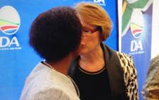 Agang SA's Mamphele Ramphele and Democratic Alliance's Hellen Zille kiss after announcing the two parties' merger on 28 January 2014. Picture: Roderick Macleod via @RodMacleod.