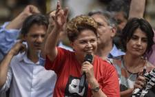 In this file photo taken on 21 September 2018 the former Brazilian President and candidate for the Senate of Minas Gerais of Brazil's Workers' Party (PT), Dilma Rousseff (C), speaking to supporters during a campaign rally in front of the Museum of Inconfidence in Ouro Preto, Minas Gerais state, Brazil. Picture: AFP.