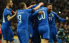 Italy's striker Lorenzo Insigne celebrates with teammates after scoring their first goal from the penalty spot during the International friendly football match between England and Italy at Wembley Stadium in London on 27 March, 2018. Picture: AFP