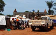 "UN peacekeepers from Gabon patrol in the Central African Republic town of Bria on 12 June 2017. After a renewed flare of violence in the region of Bria, the UN called the Central Africans to find a political solution and international donors to ""keep their promises"" of aid. Picture: AFP"