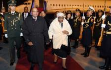 President Jacob Zuma and his wife Sizakele arrive at Beijing Capital Airport in the People's Republic of China. Picture: GCIS.