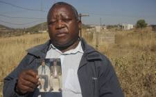 3 July 2021: Hlalu Bhembe holds a picture of his brother Vusumuzi Bhembe, who was murdered by state security officers in Ngculwini, eSwatini. Picture: Magnificent Mndebele/New Frame