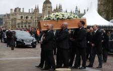 Stephen Hawking's coffin is carried into the church by six porters from the Gonville and Caius College at the Church of St Mary the Great, in Cambridge on March 31, 2018. Picture: AFP.