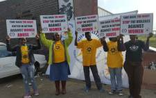 Supporters stand outside the Khayelitsha Magistrates Court at the bail hearing two suspects in the Sinoxolo Mafevuka murder case. Picture: Monique Mortlock