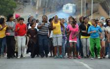 Women and children sing and dance during a second day of a housing protest in Sir Lowry's Pass Village on 10 May 2012.