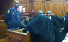 Alleged gunman in the Anni Dewani murder, Xolile Mngeni, chats with his lawyers on 30 august 2012. Picture: Nathan Adams/EWN