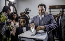 President of the Democratic Republic of Congo Joseph Kabila casts his vote along with his family at the Insititut de la Gombe polling station during general elections in Kinshasa on 30 December 2018. Picture: AFP