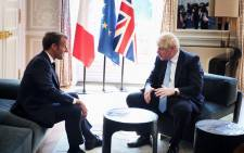 French President Emmanuel Macron (L) and Britain's Prime Minister Boris Johnson (R) speak during a meeting at the Elysee Palace in Paris on 22 August 2019. Picture: AFP