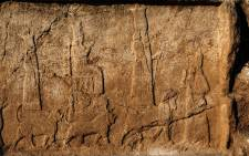 An undated handout picture provided by Terra Di Ninive on October 24, 2021, shows a view of carvings discovered on the walls of an ancient irrigation canal by a team of Kurdish and Italian archaeologists near Faydeh in the Nineveh area of northern Iraq. Picture: Terra Di Ninive / AFP.