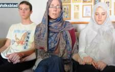 Yolande Korkie is flanked by her children during an emotional appeal to al-Qaeda to release her husband Pierre just two days before the group has said it would execute him. Picture: Volksblad.