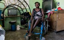 Herlande Mitile, 36 poses inside her house in Croix des Bouquets, 12.9km (8 miles) northeast of Port-au-Prince on December 30, 2019. Picture: AFP
