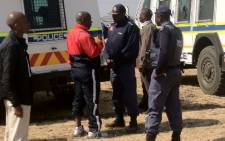 Expelled ANCYL leader Julius Malema with police on 18 August 2012. Picture: Taurai Maduna/EWN.