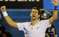 World Number 1 Novak Djokovic celebrates after beating Andy Murray in the Semi-Final of the Australian Open in Melbourne. Picture: AFP