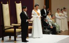 Japan's new Emperor Naruhito (L) delivers his speech next to Empress Masako (2nd L) during a ceremony to receive the first audience after the accession to the throne at the Matsu-no-Ma stateroom inside the Imperial Palace in Tokyo on 1 May 2019. Picture: AFP