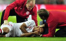 Theo Walcott needs treatment for an abdominal injury and is ruled out of England's World Cup qualifiers