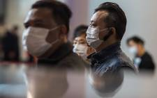 Passengers at a train station connecting Hong Kong to mainland China, wearing masks as a preventative measure following a coronavirus outbreak which began in the Chinese city of Wuhan. Picture: AFP.
