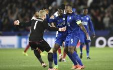 Leicester City's Wilfred Ndidi (C), Wes Morgan (R) and Kasper Schmeichel (L) celebrate a victory. Picture: AFP