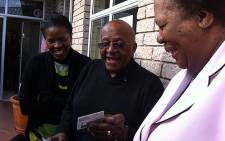 Archbishop Emeritus Desmond Tutu receives his new identity documentation on 25 July 2013. Picture: Carmel Loggenberg/EWN