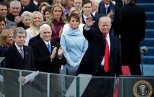 FILE: US President Donald Trump waves to the crowd after taking his oath of office. Picture: AFP.