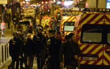FILE: Police forces and rescuers walk through rue Oberkampf near the Bataclan concert hall in central Paris, early on 14 November 2015 after terror attacks. Picture: AFP