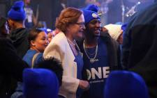 Former Leader of the DA, Helen Zille takes pictures with supporters at the party's Workers Day Rally. Picture: Cindy Archillies/EWN