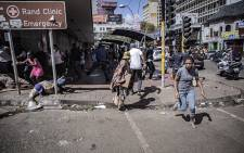 Hillbrow residents has to be dispersed with teargas on the first day of the national lockdown to stop the spread of the coronavirus. Picture: Sethembiso Zulu/EWN