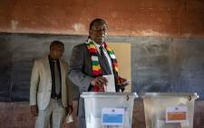 Zimbabwean President Emmerson Mnangagwa casts his vote on 30 July 2018. Picture: Thomas Holder/EWN