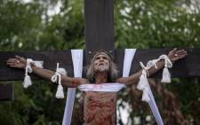 A Philippine Christian devotee is nailed to a cross during a reenactment of the Crucifixion of Christ during Good Friday ahead of Easter in San Juan, Pampanga, on 19 April 2019. Picture: AFP