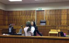 FILE. Sindisiwe Manqele being briefed by counsel on Tuesday 9 September 2015 ahead of testifying in her murder trial. She is accused of killing her rapper boyfriend Nkululeko 'Flabba' Habedi at his home in Alexandra in March. Picture: Masego Rahlaga/EWN