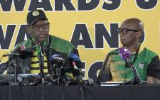 The ANC's Mathole Motshekga left) reports back on constitutional amendments discussed during commissions at the ANC's 54th elective conference. Picture: Louise McAuliffe/EWN