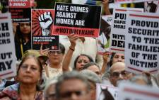 Indian demonstrators hold placards during a silent protest 'Not In My Name' in support of rape victims following high profile cases in Jammu and Kashmir and Uttar Pradesh states, in New Delhi on 15 April, 2018. Picture: AFP